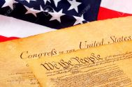 283493-US-Constitution-and-American-Flag-Stock-Photo.jpg
